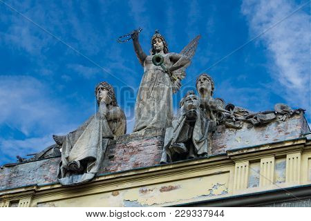 Sculptures On The Roof Of Arena Del Sole Theatre In Bologna, Italy. This Historc Theatre Was Built I