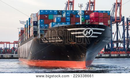 Rotterdam, Netherlands - Jul 9, 2013: Bow View Of A Container Ship Leaving The A Terminal In The Por