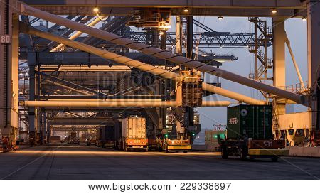Rotterdam - Sep 6, 2013: Automated Guided Vehicles Moving Shipping Containers To And From Gantry Cra