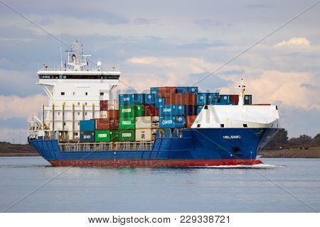 Rotterdam - Sep 8, 2013: Cargo Container Ship Leaving The Port Of Rotterdam.