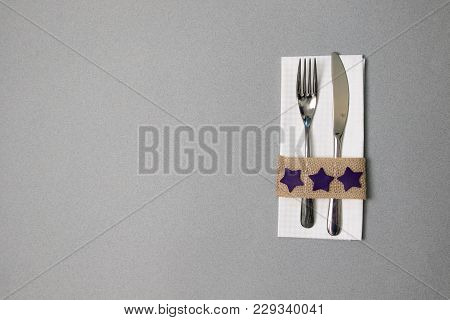 White Napkin, Knife And Fork, Place For Dinner Served In Rustic Style