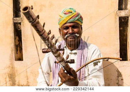 Musician playing traditional rajasthani music on the street of Jaipur