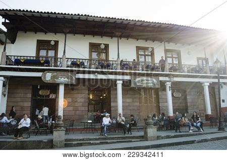 Valle De Bravo, Mexico- February 17, 2018: Historic Building With People At Twilight In A Typical Da