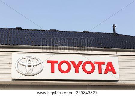 Logstor, Denmark - August 23, 2017: Toyota Logo On A Facade. Toyota Motor Corporation Is A Japanese
