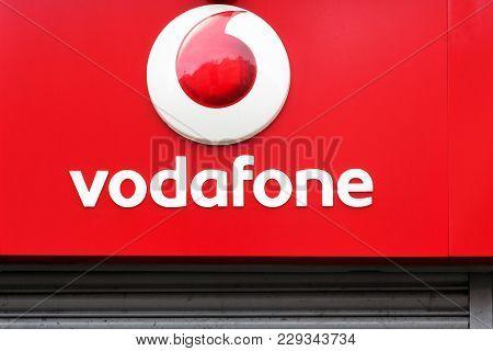 London, United Kingdom - January 31, 2018: Vodafone Logo On A Wall. Vodafone Is A British Multinatio