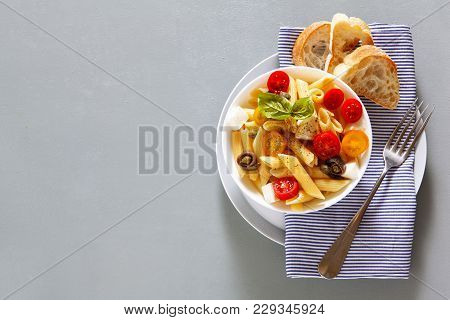 Healthy Summer Light Pasta Salad With Fresh Raw Tomatoes, Anchovies And Capers