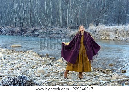 Model Posing Against The Backdrop Of A Mountain River