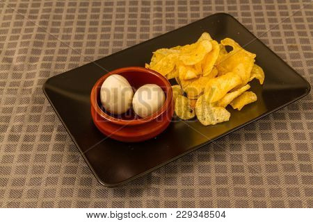 Two Pickled Eggs With Crisps Or Chips