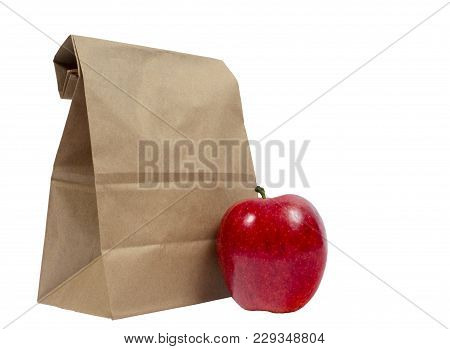 Horizontal Shot Of The Back Of A Brown Paper Bag With The Top Folded Down.  In Front Of This Is A Re
