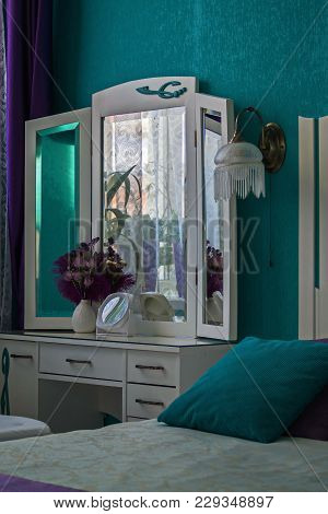 Interior 2. Dressing Table, Vase, Mirror, Sconce. Bedroom In Turquoise Tones.