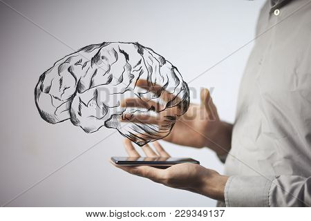 Hand Holding Smartphone With  Brain In Scree