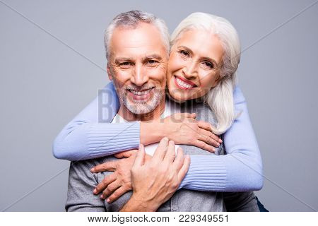 Close Up Portrait Of Happy Excited Senior Couple, They Are Embracing And Smiling, They Love Each Oth