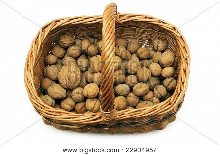 Wicker basket with nuts isolated on a white background