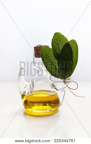 Olive Oil In A Small Glass Jar & Sage Leaves