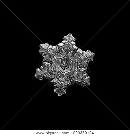 Snowflake Isolated On Black Background. Macro Photo Of Real Snow Crystal: Small Stellar Dendrite Wit