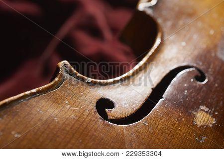 Old Vintage Instrument Lieing On Red Velvet