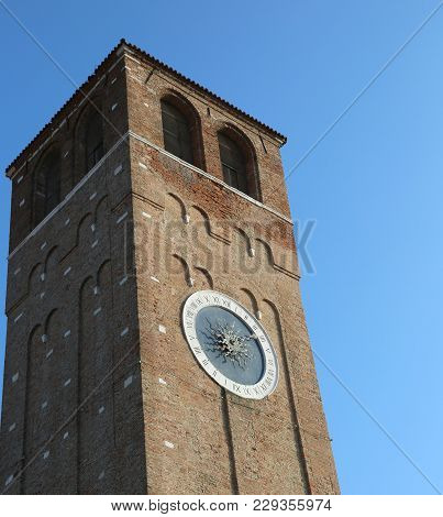 Clock Tower In Downtown Of Chioggia Island Near Venice In Italy