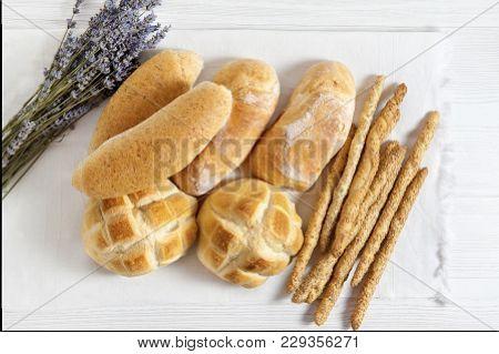 Fresh Homemade Italian Bread: Ciabatta, Wholemeal, Turtle, Gressini. Breadsticks With Sesame Seeds.