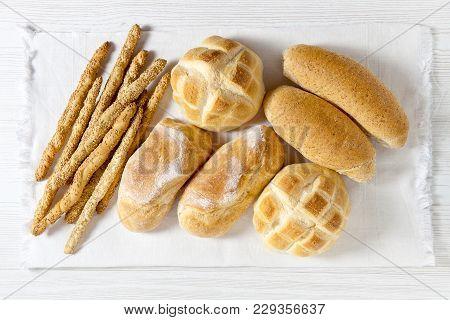 Fresh Homemade Italian Bread: Ciabatta, Wholemeal, Turtle, Gressini. Breadsticks With Sesame Seeds