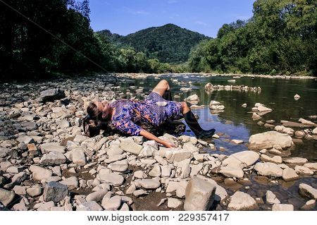 Nature Of The Carpathians. A Girl Rests In The Carpathians. Rest Of A Young Woman On A Lake. Rest On