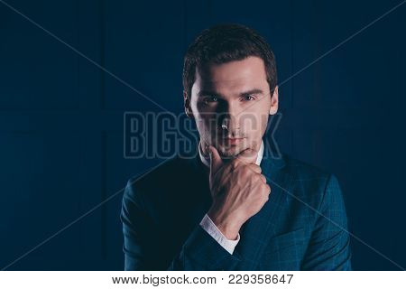 Close Up Portrait Of Trendy, Perfect, Attractive Banker Holding Hand On Chin With Serious Expression
