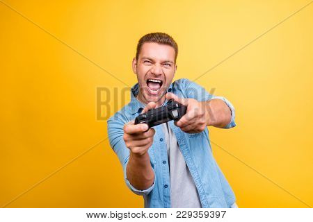 Portrait Of Young, Cheerful, Attractive, Very Excited Guy Holding Joystick And Playing Video Games O