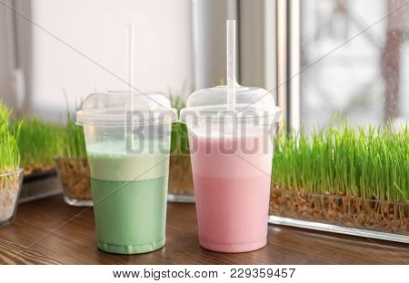 Different protein shakes on window sill in sport bar