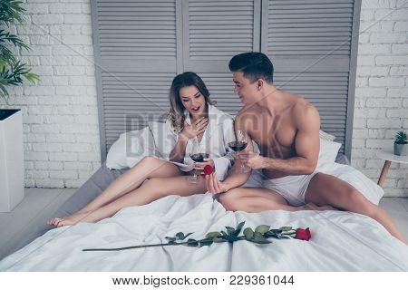Muscular Man Propose To Merry Him Giving Engagement Ring In Red Box To His Amazed Lover, Couple Hold
