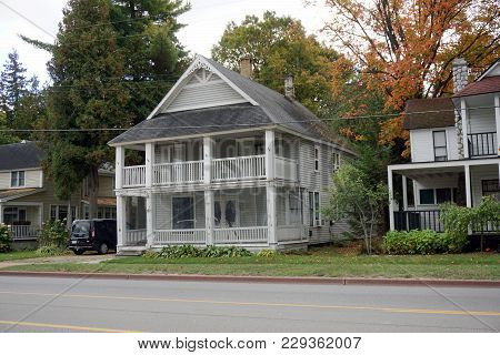 Bay View, Michigan / United States - October 16, 2017:  A Large Gray Two Story Victorian Cottage, Wi