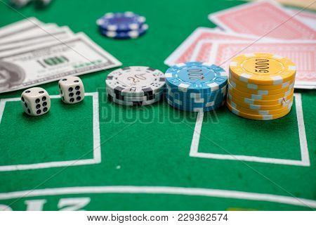 Poker Chips And Banknotes On Table In Casino