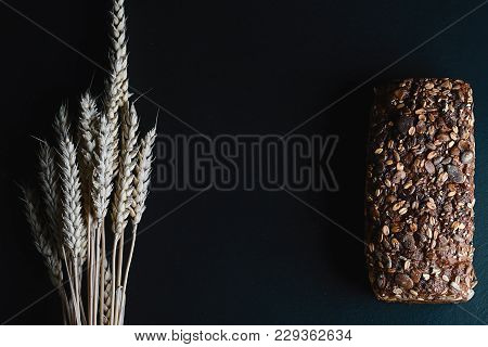 Dark Rye, Cereal Bread With Sunflower Seeds, Whole Bread, Wheat Stems On A Dark Background Shale Boa