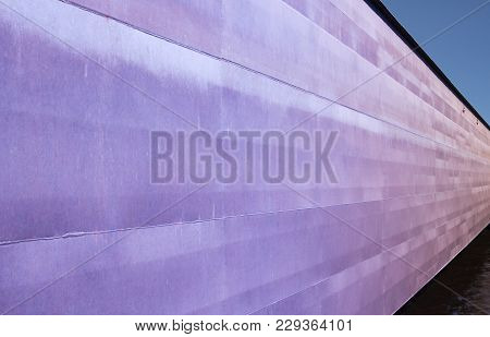 Industrial Violet Structure. Colorful Industrial View Of Outgoing Steel Wall Which Is Used For Prote