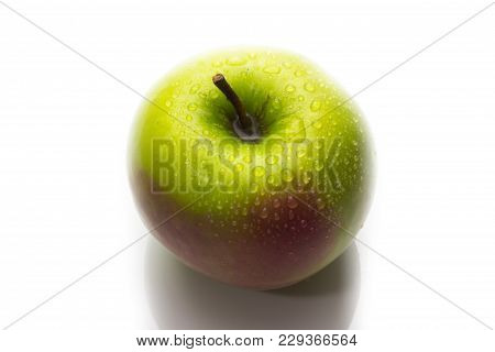 A Red And Green Apple With Water Drops Isolated On A White Background.