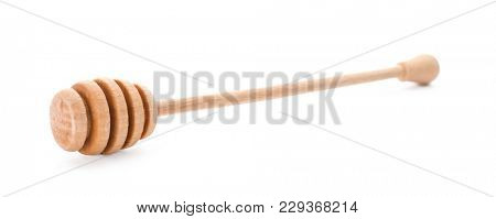 Wooden honey dipper on white background. Handcrafted cooking utensils
