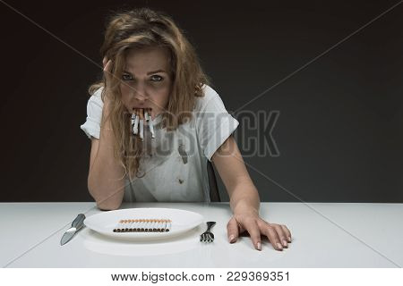 Portrait Of Displeased Lady Looking At Camera With Disgusting Face While Holding Bunch Of Cigarettes