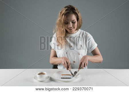 Waist Up Portrait Of Delighted Girl Sitting And Consuming Nicotine And Caffeine. Copy Space In Left