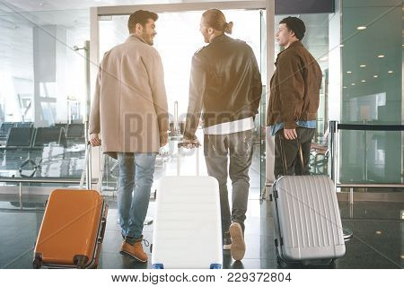 Full Length Side View Happy Friends Keeping Luggages While Going In Airport. Communication And Trip