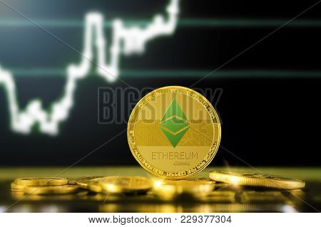Ethereum Classic (etc) Cryptocurrency; Gold Ethereum Classic Coin On The Background Of The Chart