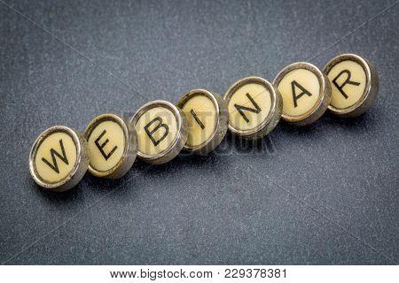 webinar word spelt in vintage typewriter keys against gray slate stone