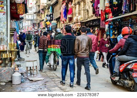 KATHMANDU, NEPAL - CIRCA JANUARY 2017: Street scene in the Asan neighbourhood.