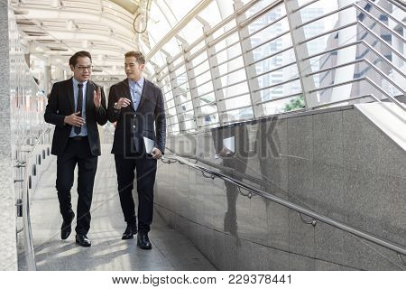 Two Business Talking With Partner About Business And Invetment  On Way To Office