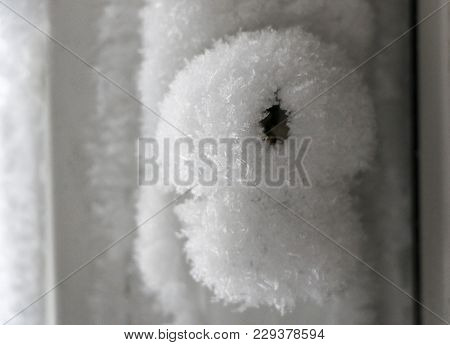 door handle and keyhole are covered with frost. severe frosts.  door freezes. icy handle and lock co