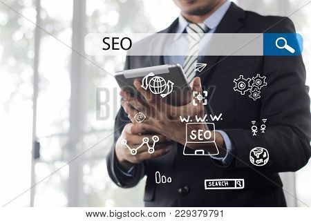 Searching Engine Optimizing Seo Browsing Concept, Businessman Holding Phone For Looking Information