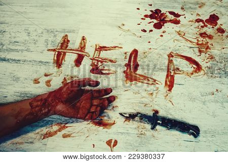 Says Help, Written In Red Blood On The Dirty White Floor Of The Bloody Hand. The Murder Victim Asks