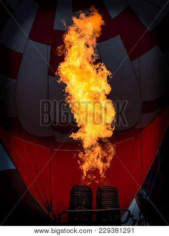 Hot Air Balloon Inflated By Fire From Burner. Flame Tongue.