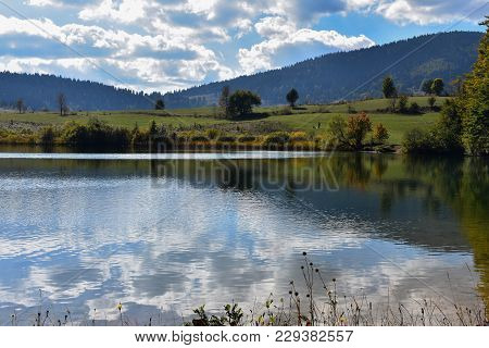 Forest Lake In Mountains, Place For Walking, Relaxation And Tranquil Vacation
