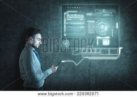 Businessman Using Smartphone. The Hologram Interface On Smartphone.