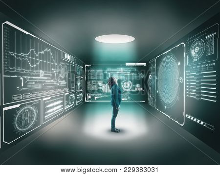 Young Girl In Center Of A Room Looking Up Through A Hole, Izolated In A Room With Hi Tech Graphs And