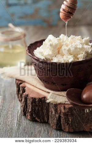 Dairy Product Curd In Brown Ceramic Bowl. Curd In Clay Bowl. Fresh Cottage Cheese In Bowl With Spoon