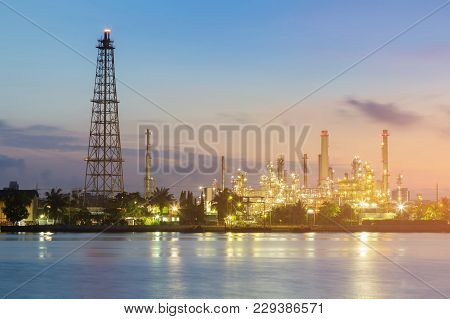 Night Light Over Petroleum Refinery Factory River Front, Industrial Background